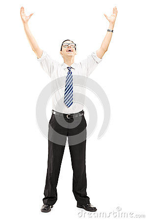 Excited young man with raised hands