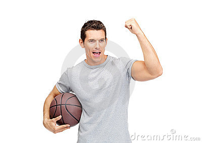 Excited young manholding a basket ball and cheeri