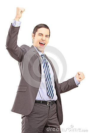 Excited young professional man gesturing happiness