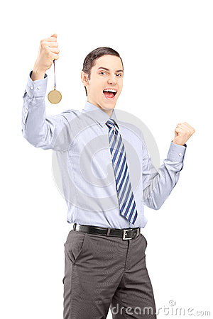 Excited young professional man gesturing happiness with medal in