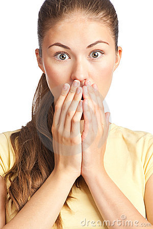 Excited young woman covering her mouth