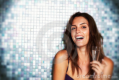 Excited young woman with a glass of wine