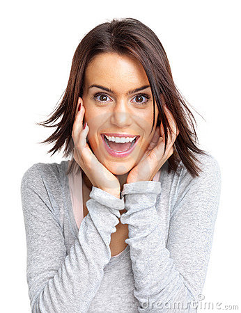 An excited young woman holding her face