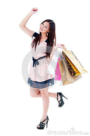 Excited Young Woman Holding Shopping Bags