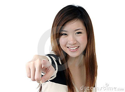 Excited young woman pointing at camera