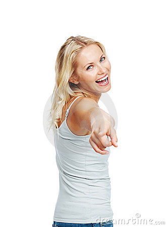 Excited young woman pointing at you against white