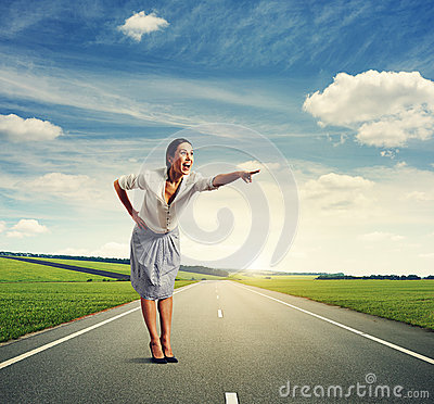 Excited young woman standing on the road