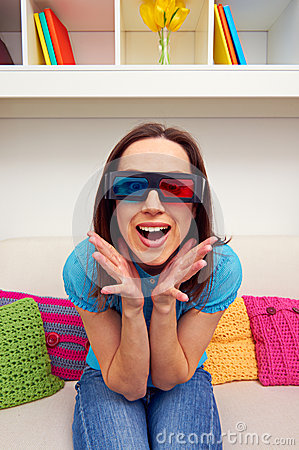 Excited young woman in stereo glasses