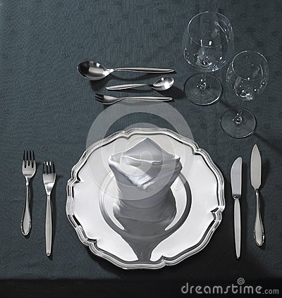 Exclusive place setting on dark tablecloth