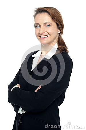 Executive in business suit standing arms folded