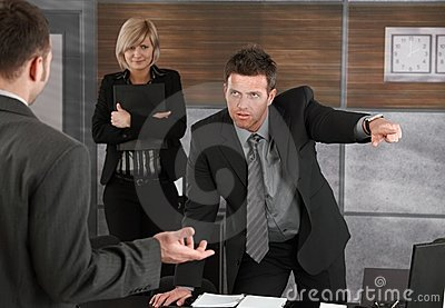 Executive firing employee Stock Photo