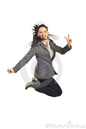Executive jumping and show victory sign