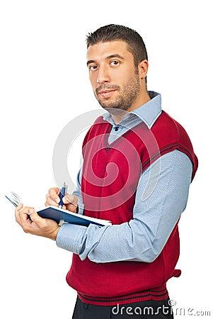Executive man holding agenda and pencil