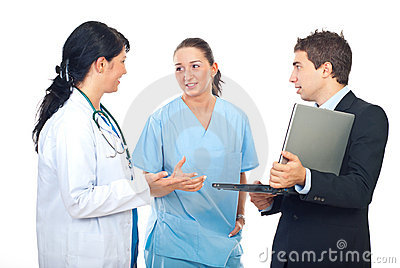 Executive man with laptop converse with doctors