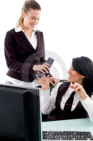 Executive taking phone receiver from her secretary