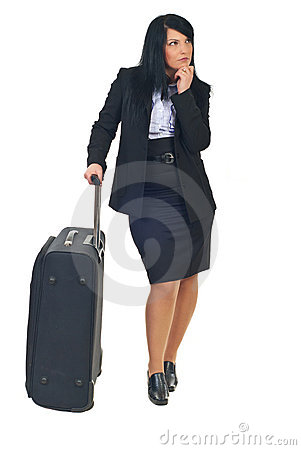 Executive woman with suitcase waiting