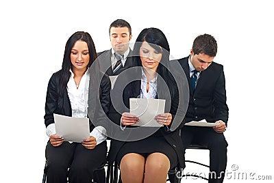 Executives reading at conference