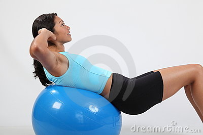 Exercise stomach crunches by athletic young woman