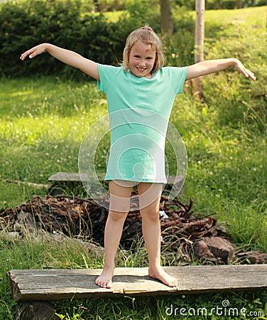 Exercising little girl