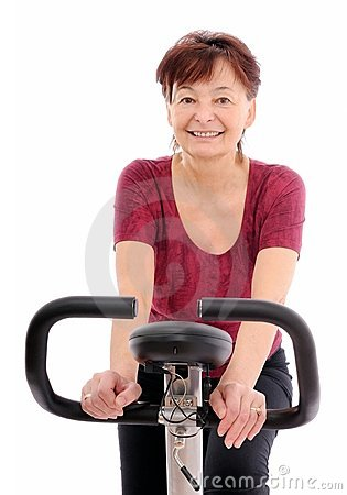 Exercising senior woman isolated