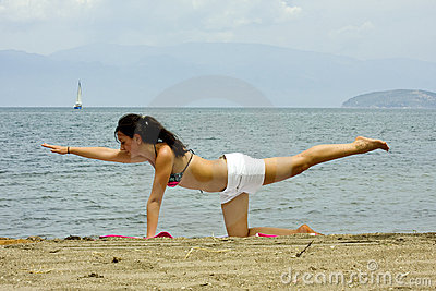 Exercising woman on the beach