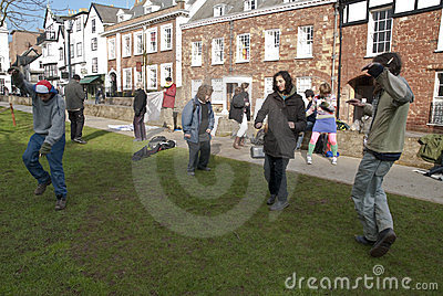 Exeter Occupy activists dance on Cathedral green Editorial Image