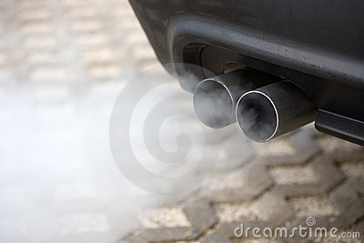 Exhaust pipe of a car blowing
