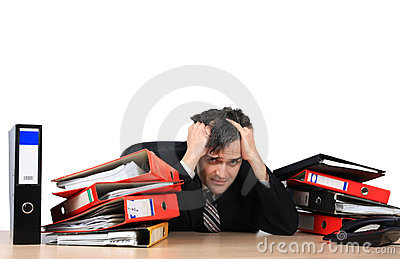 Exhausted businessman in his office