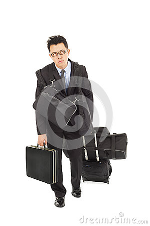 Exhausted businessman taking all bags