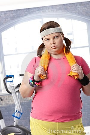 Exhausted fat woman at the gym