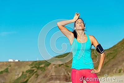 Exhausted female runner overtraining