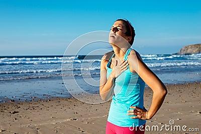 Exhausted female runner suffering angina pectoris