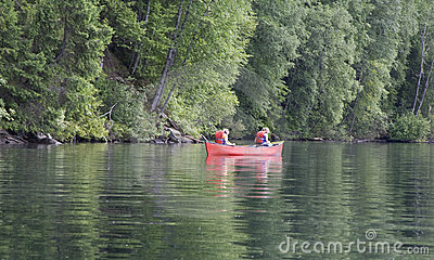 Exhausted girl and boy canoeing