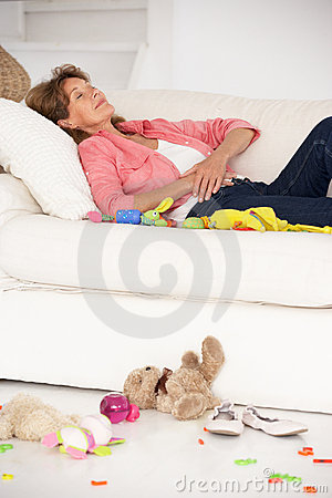 Exhausted grandmother enjoying a rest on sofa