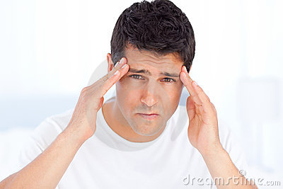 Exhausted man suffering from a headache