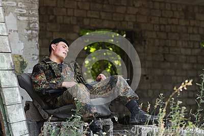 Exhausted soldier taking rest