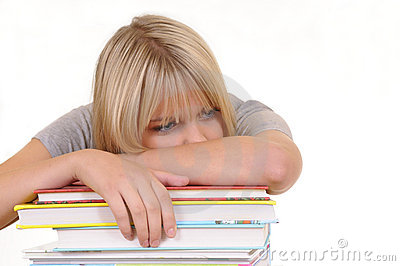 Exhausted woman on a stack of books