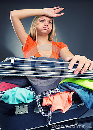 Free Exhausted Young Woman Packing Luggage Royalty Free Stock Photography - 34532907