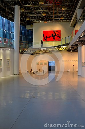 Exhibit hall with lady at art gallery Shanghai, China Editorial Stock Photo