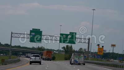 Exit sign to Elizabethtown on the freeway - Nashville, United States - June 16, 2019. Exit sign to Elizabethtown on the freeway - Nashville, Tennessee - June 16 stock footage