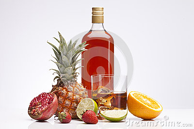 Exotic alcohol drinks, set and whisky with fruits