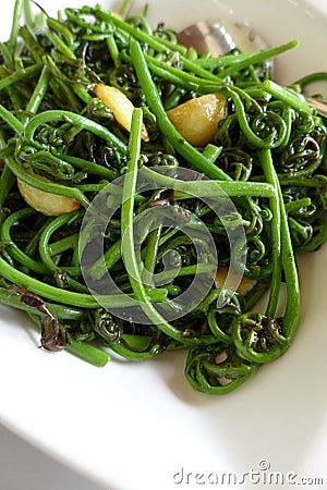Exotic asia cuisine - jungle ferns stir fry dish