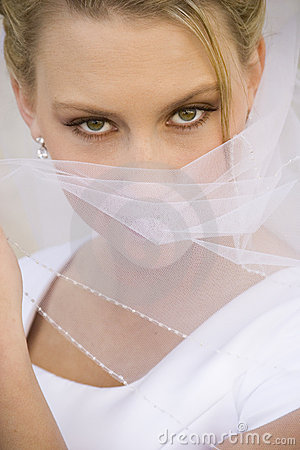 Exotic Bride Covers Face with Veil