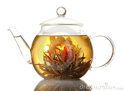 Exotic green tea with flowers in glass teapot