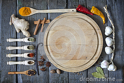 Exotic spices and empty cutting board