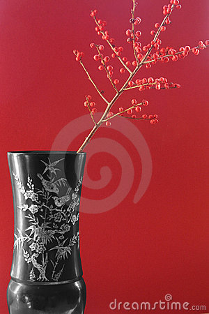 Exotic vase with red berries