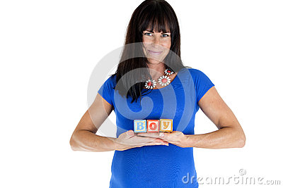 Expectant model holding wooden toy blocks which spell out boy