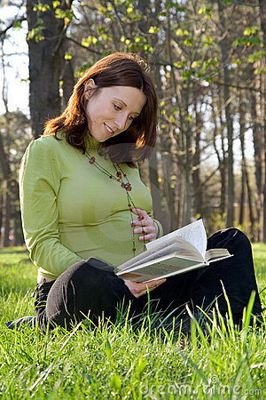 Expectant mother reads the book