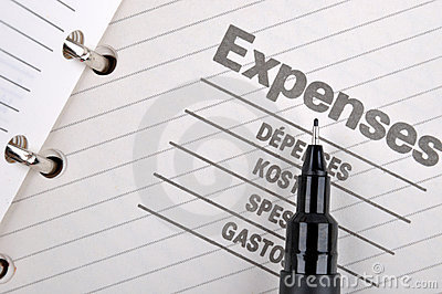 Expenses record and black pen