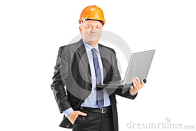 Experienced engineer posing with a laptop